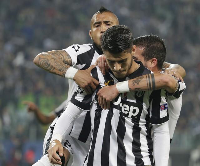 Morata fez o primeiro e pouco comemorou. (Foto: AP)