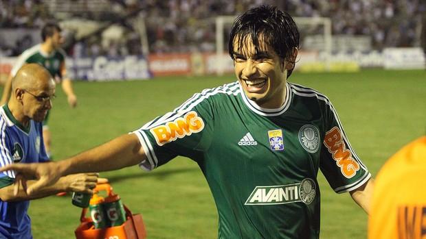 Tiago Real comemora o terceiro gol do verdão. Foto: Cesar Greco /AE